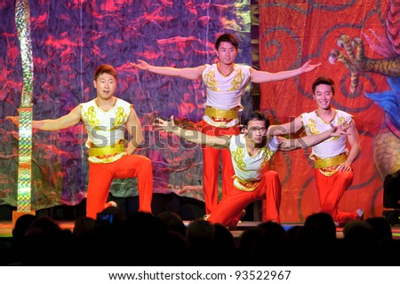 LINCOLN, CA - JAN 20: The Chinese Acrobats Of Hebei perform hoop diving at Thunder valley Casino in Lincoln, California on January 20, 2012