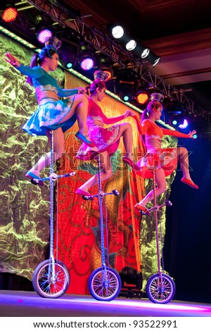 LINCOLN, CA - JAN 20: The Chinese Acrobats Of Hebei perform juggling on unicycles at Thunder valley Casino in Lincoln, California on January 20, 2012