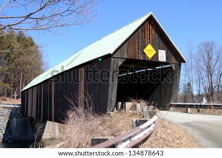 Lincoln Covered Bridge, in West Woodstock, Vermont. spans the Ottauquechee River. The truss bridge was built in 1877 and is 136 feet long.