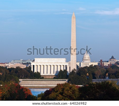 Lincoln Memorial, Washington Monument and Capitol building aligned as the sun starts to set in the fall