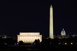 Lincoln Memorial, Washington Monument, and National Capitol at night. View from Arlington. Washington DC, USA.