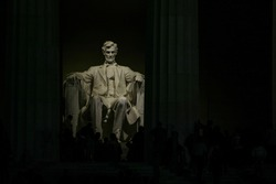Lincoln's statue gently lit at night in Lincoln Memorial