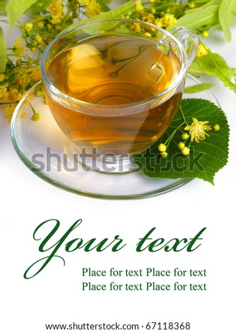 Linden tea in a transparent cup and linden flowers