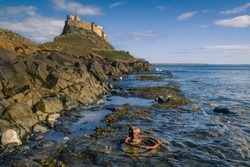 Lindisfarne Castle old harbor Northumberland rusty iron ring ancient sea
