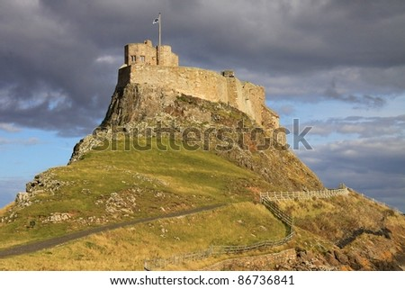 Lindisfarne castle on a sunlit afternoon in Autumn, Holy Island, United Kingdom