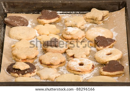 Line a baking tray with delicious Christmas cookies/ Christmas Cookies