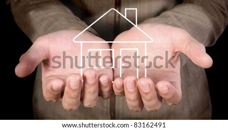 line-art house in human hands