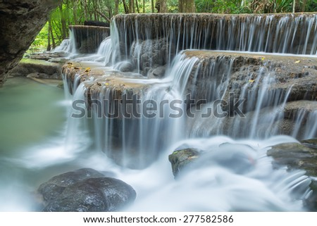 Line dance, rock waterfall in the forest.