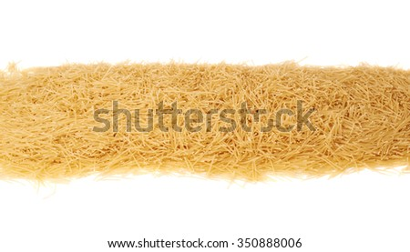 Line made of dry noodles yellow pasta over isolated white background #350888006