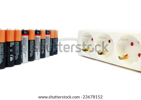 Line of AA batteries with power extension cord isolated on white. Alternative energy concept.