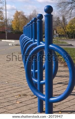line of bicycle stands near parking lot
