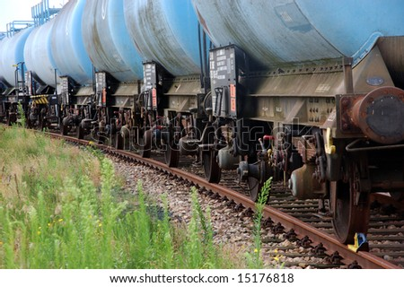 Line of blue train tank wagons