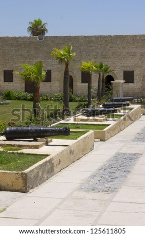 Line of cannons in the entrance yard of the Citadel of Qaitbay surrounding the main entrance to the front gate