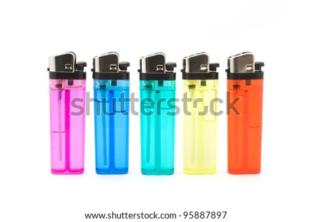 Line of cigarette lighters over white