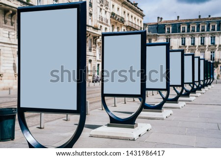 Line of clear billboards on city street with blank copy space screen for advertising or promotional poster content, empty mockup Lightboxes for information, blank displays outdoors in urban area