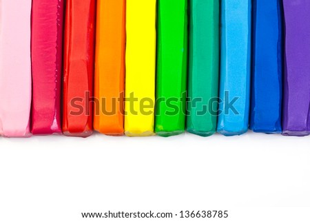 Line of colorful clay on white background