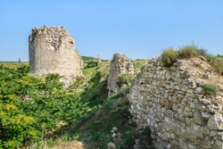 Line of defensive walls and tower of medieval fortress Kalamita, Inkerman, Crimea. Stronghold was founded by Byzantines in near cave church, that later became Inkerman Cave Monastery of St Clement