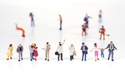 Line of diverse tiny miniature model people