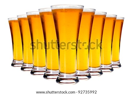 Line of glasses with lager beer isolated on white