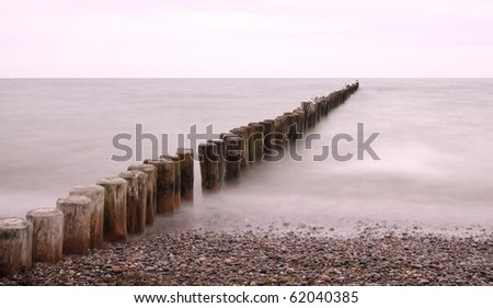 Line of Groynes 01 - stock photo