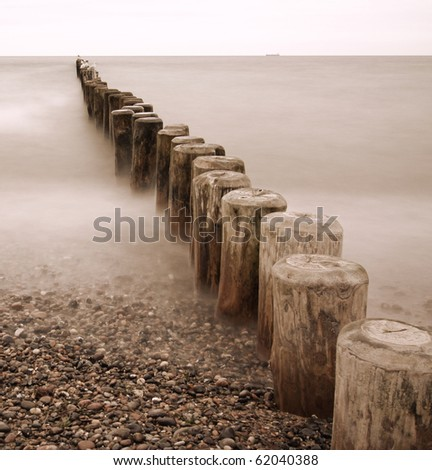 Line of Groynes 02 (sepia-tone) - stock photo
