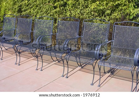 Line of metal outdoor chairs