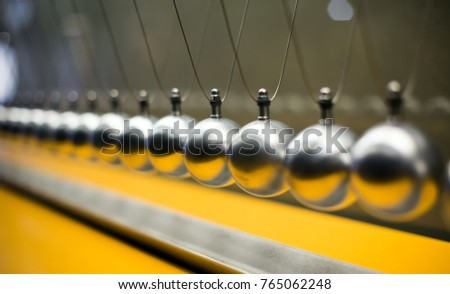 Line of metallic globes for Cartesian impulse conservation law experiment #765062248