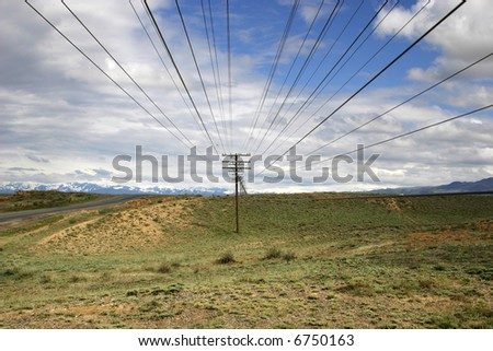 Line of Old telephone posts in Kazakh steppe.