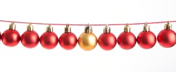 Line of red christmas balls on white background. Christmas decorations.