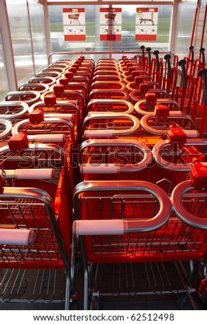 line of red shopping cart