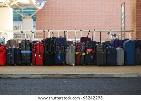 Line of suitcases in the airport - stock photo