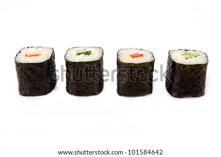 Line of sushi roll over white