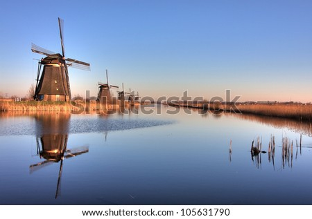 Line of Windmills reflection in Holland. Kinderdijk