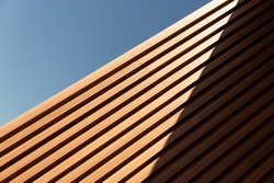 line of wood in detail building and blue sky abstract architecture background