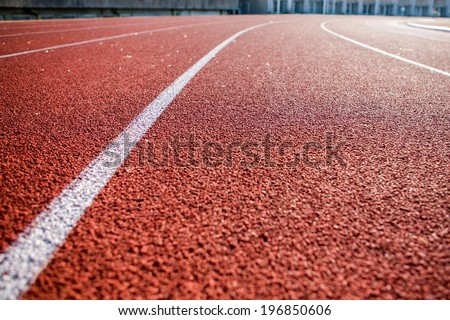 Line on running track with rubber cover