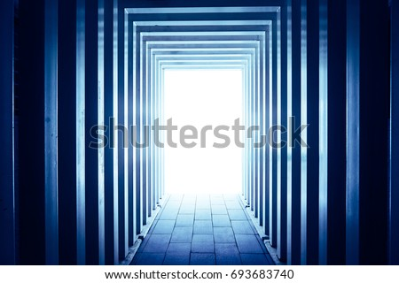 Line-shaped corridors leading to unknown bright exit door . #693683740