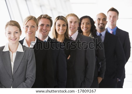 Line up of office staff facing camera