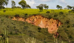 Linear gully-type erosion, an erosive process deepening until it meets the underground water table, where the erosive effects will be more intense. Alexania. Goias, Brazil, Sep 2016