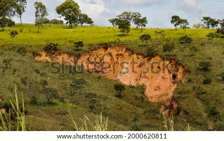 Linear gully-type erosion, an erosive process deepening until it meets the underground water table, where the erosive effects will be more intense. Alexania. Goias, Brazil, Sep 2016 Stock photo ©