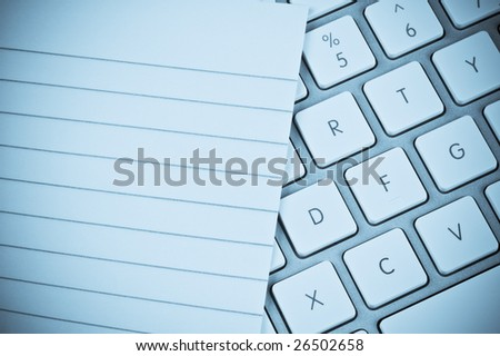 Lined pad of paper and a computer keyboard