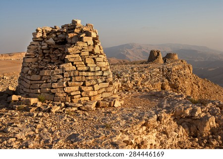 Lined up dramatically atop a rocky ridge, the Beehive Tombs of Bat, in Oman, are 4000-5000 years old and a Unesco World Heritage Site.