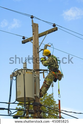 lineman working on hydroelectric pole