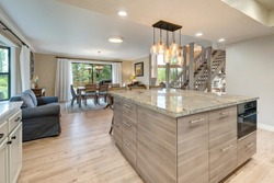 Linen, beige, light oak, Luxury home dining room and kitchen interior with natural rustic modern deisgn.
