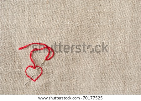 linen canvas with red heart embroidered on it