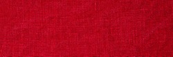 Linen fabric crumpled texture, copy space banner. Stone washed pure linen red background