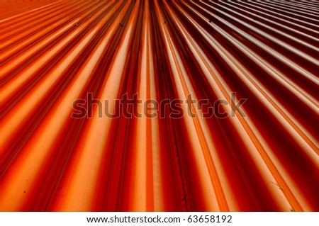 Lines of an orange factory cladding