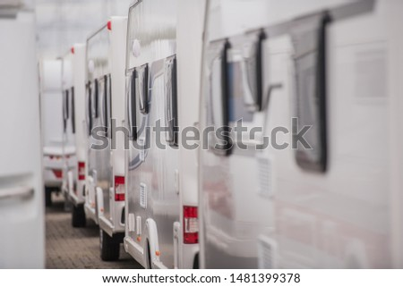 Lines of Brand New Travel Trailers. Recreational Vehicles Sale. RV Dealer Lot. Industrial Theme. #1481399378