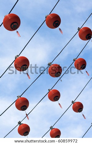 Lines of multiple red lanterns at Chinese temple