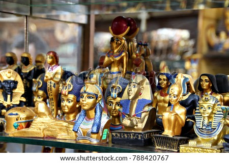 Lines of trinkets and curios line a shelf in a shop for tourists in Cairo, Egypt. #788420767