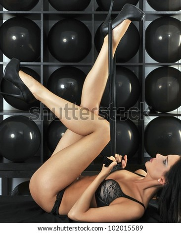 Lingerie model making classic rabbit pose legs up